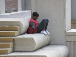 Reader on Kansas City Library Stairs
