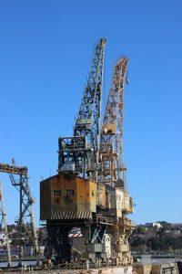 Two ship cranes.