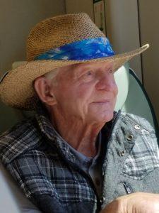 Elderly man in straw hat