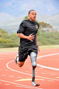 0984-FieldsRuns200.jpg: U.S. Army World Class Athlete Program Paralympic sprinter hopeful Sgt. Jerrod Fields works out at the U.S. Olympic Training Center in Chula Vista, Calif. A below-the-knee amputee, Fields won a gold medal in the 100 meters with a time of 12.15 seconds at the Endeavor Games in Edmond, Okla., on June 13. Photo by Tim Hipps, FMWRC Public Affairs
