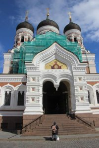 Russian Orthodox Cathedral with a mendicant out front.