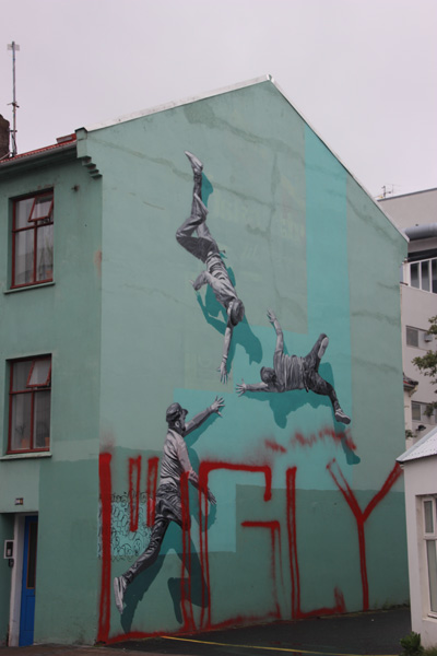 Three Men Flying. I think the letters at the bottom of this mural were meant to deface it.