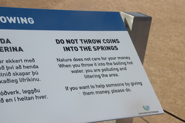 "Sign warning not to throw coins into the mineral spring. ""Nature does not want your money."""