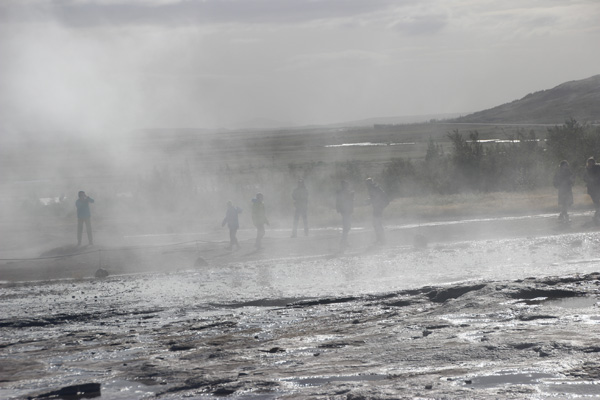 Watchers doused with steam and spray from Strokker geysir.
