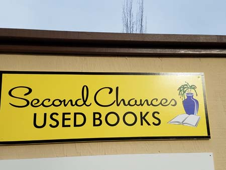 Second Chances Used Book Sign with the book and vase logo