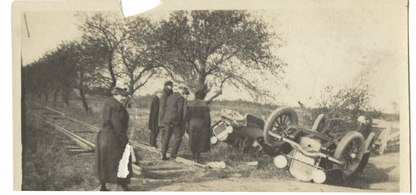 Two roadsters wrecked while spectators stand by. Cars have always been a risky business, even on Oct 29, 1922.