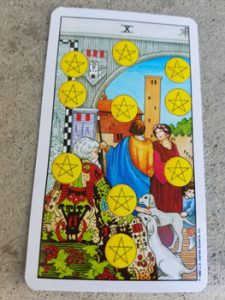 The Ten of Pentacles, to which the Ten of Diamonds corresponds.