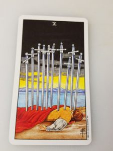 The Ten of Swords. This card will have you side-eyeing your colleagues if it shows up in a spread.