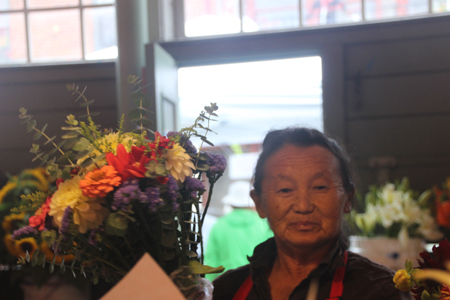 A flower vendor who graciously posed for me.