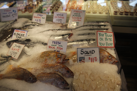 Just a small sample of the fish market's selection, but if you touch it, you just bought it.