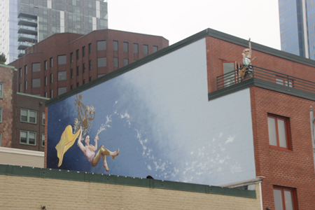 And then there is the art. Mural of a merman on he side of a building.