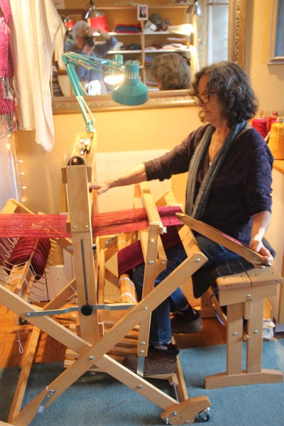 Abby at her loom.