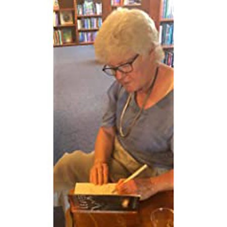 Me Signing Aluminum Leaves at Second Chances Used Books