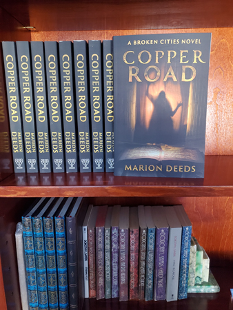Row of Copper Road books on bookshelf.