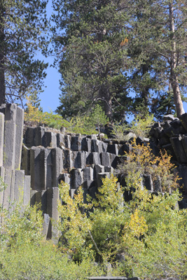 Vertical columns of basalt, covered with grass, look like stair steps.