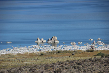 Mono Lake shore, white limestone towers with blue water.