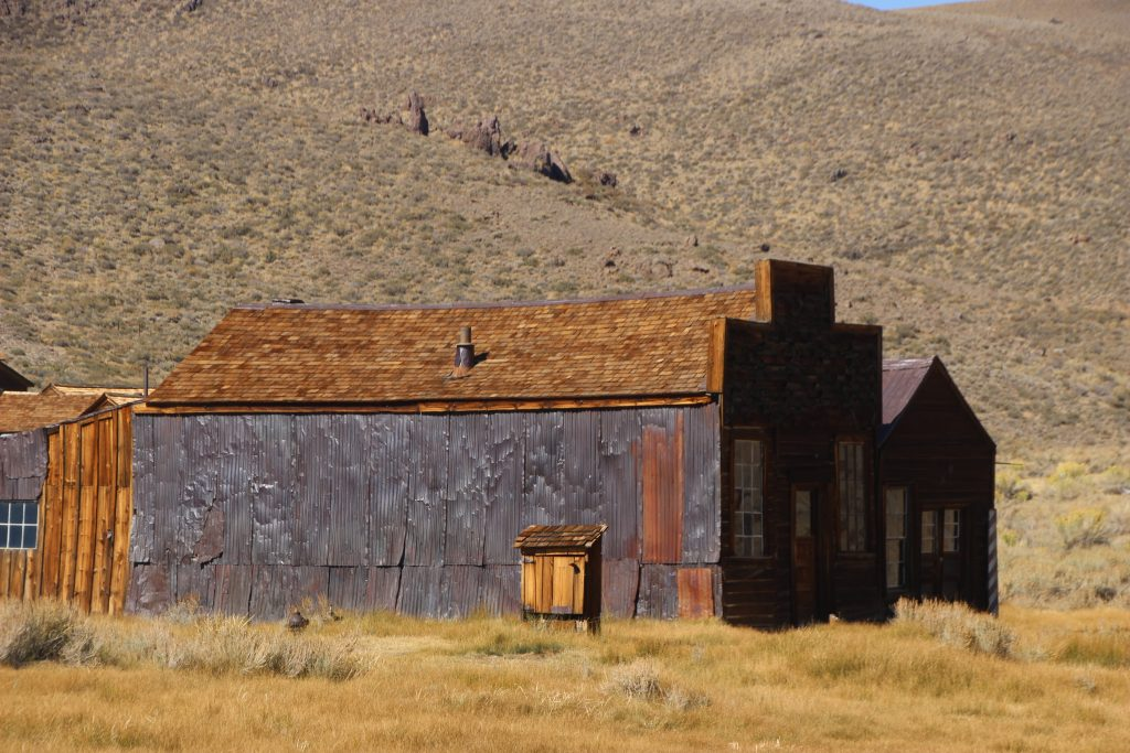 Intact Building, sheathed in copper, against hills and sky.